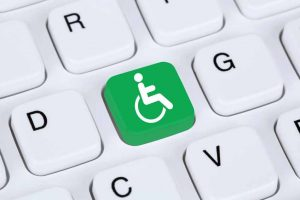 computer keyboard with green handicap accessible symbol
