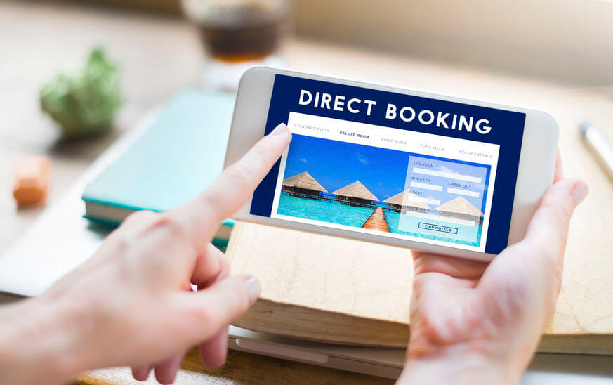 Woman booking directly on hotel mobile website