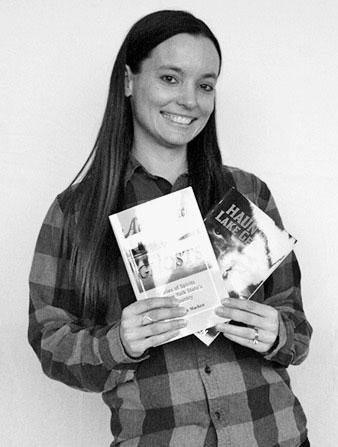 Erin Nudi holding books