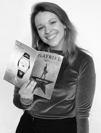 Dana Drosdick holding up a Playbill