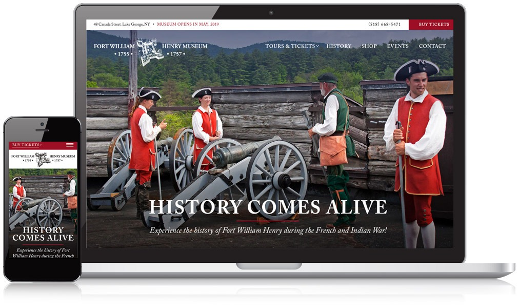 screen capture of website homepage and mobile phone of same image of soldiers in period dress around cannon