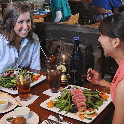 2 women eating dinner in restaurant